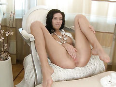 Flirtatious slut Lotus with clean snatch has fire in her eyes as she masturbates