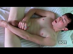 Glass dildo fucks his shaved twink butt
