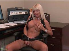 Big breasts bimbo milf masturbates lustily in office