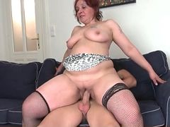Thick mature lady in fishnets rides a cock