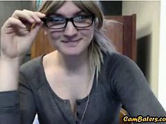 Nerdy blonde babe flashes in Library