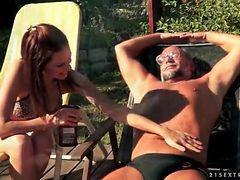 Bikini girl Mira Shine sucks old dick outdoors